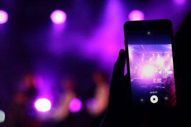shooting festival concert on smartphone