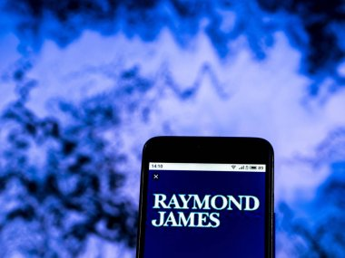 KIEV, UKRAINE - Dec 30, 2018: Raymond James Investment banking company logo seen displayed on smart phone