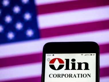 KIEV, UKRAINE - Jan 1, 2019: Olin Corporation Manufacturing company logo seen displayed on smart phone