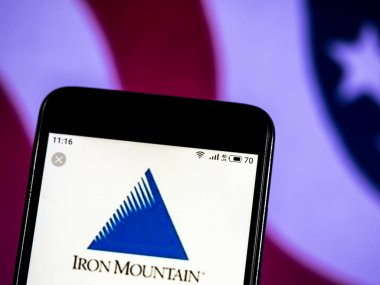 KIEV, UKRAINE - Jan 12, 2019: Iron Mountain Enterprise information management company logo seen displayed on smart phone.