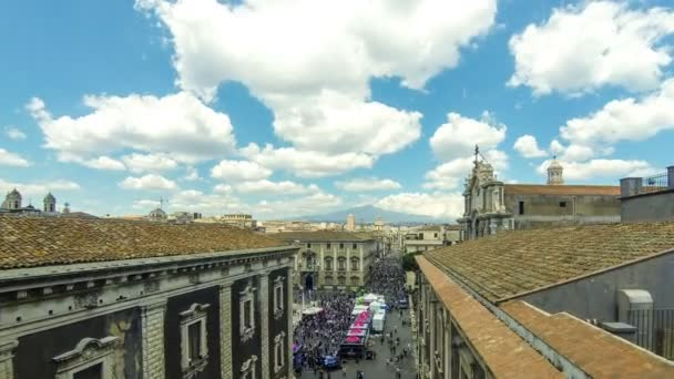 CATANIA, ITALY - MAY 7, 2018: Aerial skyline view of Catania old town, Sicily, Italy. View to Piazza del Duomo and Via Etnea street. Mount Etna on the background. Time Lapse