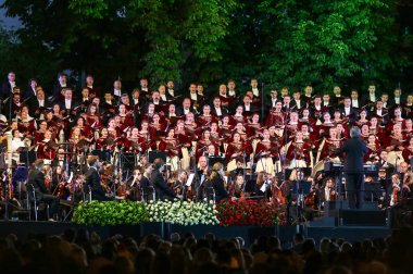 KYIV, UKRAINE - JULY 1, 2018: Orchestra Giovanile Luigi Cherubini (conductor Riccardo Muti) and Choir of the National Opera of Ukraine perform on stage during the concert at Sofiyivska Square in Kyiv