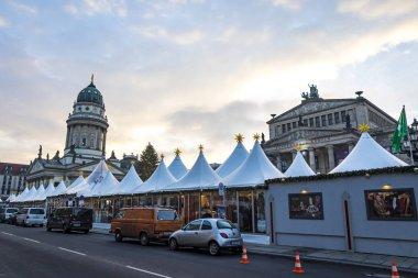 BERLIN, GERMANY - DECEMBER 18, 2018: Gendarmenmarkt Christmas Market in Berlin, Germany. One of the most famous Christmas market in Europe. Deutscher Dom and Konzerthaus on background