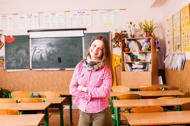 Young smiling woman teacher