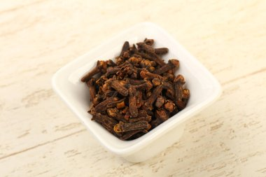 Clove seeds in the bowl - cpice for cuisine