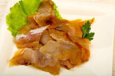 Smoked catfish fillet carpaccio