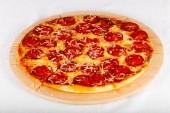 Fotografie Tasty Pizza pepperoni on white table