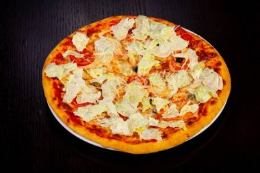Delicious caesar pizza with lettuce