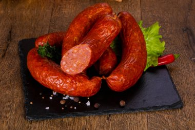 Pork sausages over wooden background stock vector