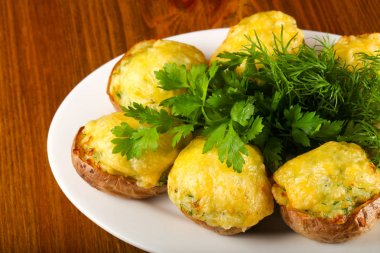 Baked potato with cheese and herbs