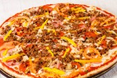 Photo Pizza with minced meat and vegetables