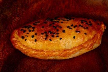 Tasty pastrie - Samosa over wooden background stock vector
