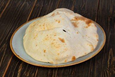 Handmade bread Lepeshka over wooden