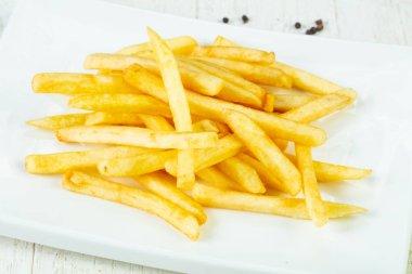 Hot tasty French fries potato
