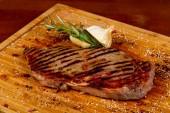 Photo Beef Striploin steak with rosemary