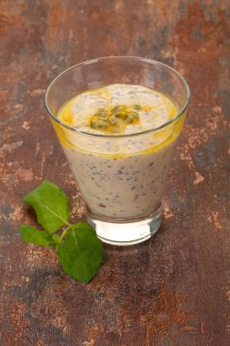 Pudding with chia and passion fruit served mint