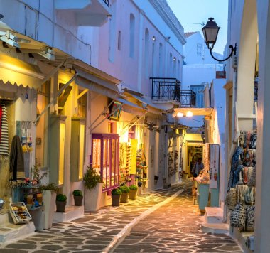 Touristic narrow street with souvenirs shops in the evening