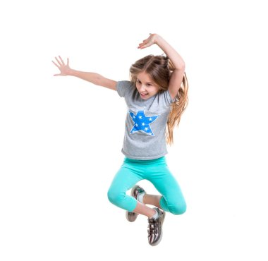 preteen jumping and enjoying her time, isolated