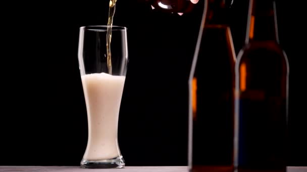 Light beer pouring in glass. With bubbles and foam.