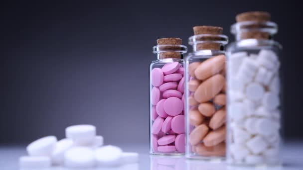 Colorful pills in bottles