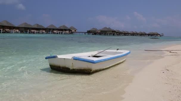 Boat at Tropical beach in the Maldives at summer day