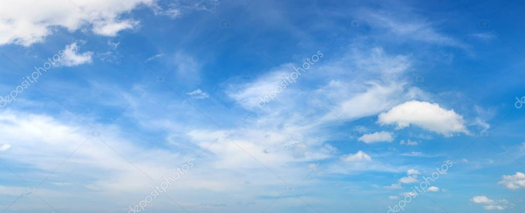 Blue sky panorama with clouds in a summer day
