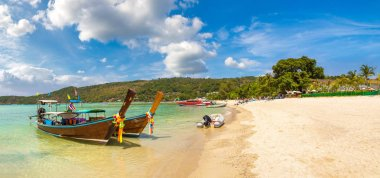 Panorama of Traditional thai longtail boat at Log Dalum Beach on Phi Phi Don island, Thailand in a summer day