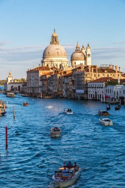 VENICE, ITALY - JUNE 18, 2014: Basilica Santa Maria della Salute and Grand Canal in Venice in a beautiful summer day in Italy on June 18
