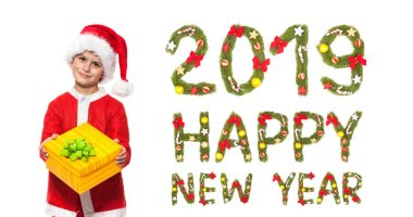 Boy holding a christmas box gift isolated on white background. 2019 New Year greeting