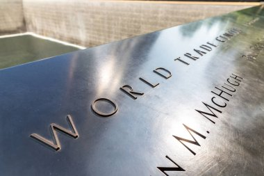 NEW YORK CITY, USA - MARCH 29, 2020: Memorial plaque at 9/11 Memorial park in New York City, NY, USA