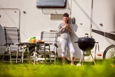 Family vacation travel RV, holiday trip in motorhome, Caravan car Vacation. Picnic with outdoor barbecue.