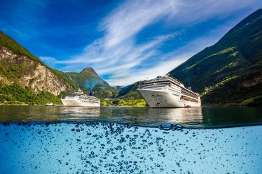 Cruise Ship, Cruise Liners On Geiranger fjord, Norway. Tourism vacation and traveling.