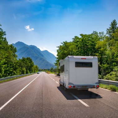 VR Caravan car travels on the highway. Tourism vacation and traveling.