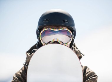 portrait of a snowboarder in a mask