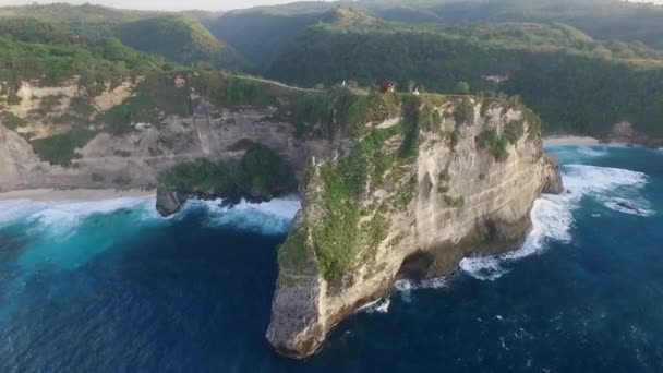 Aerial: Small Wooden House on the Cliff in Sunrise