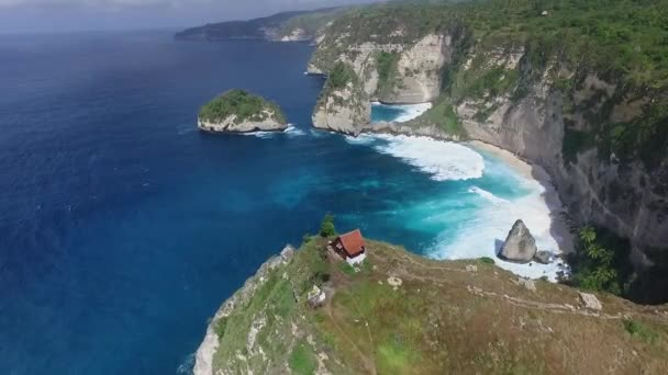 Aerial: Small Wooden House on the Cliff
