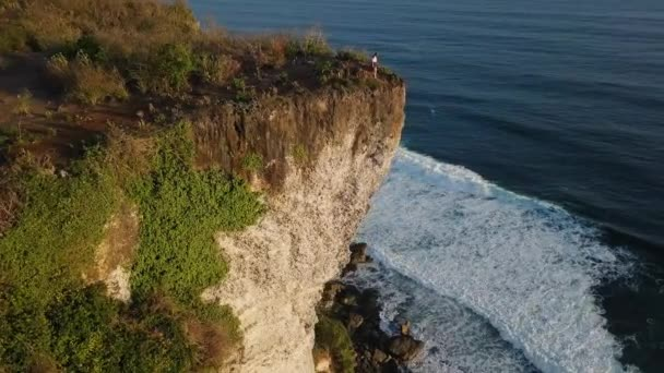 Aerial: Beautiful Top View from Cliff. Amazing Blue Ocean Waves Aerial 4K Background. Bali, Indonesia.