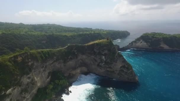 Aerial Amazing view of the Ocean with waves, rocky cliff and beach