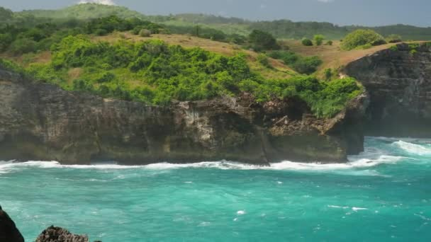 Ocean waves crashing coastline cliff