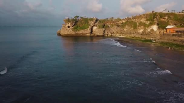 Aerial view of waves and coastline with sandy tropical beach Balangan.