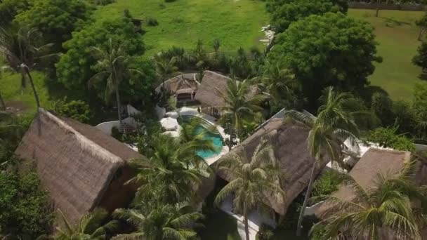 Flying over the resort hotel with villas in tropical island