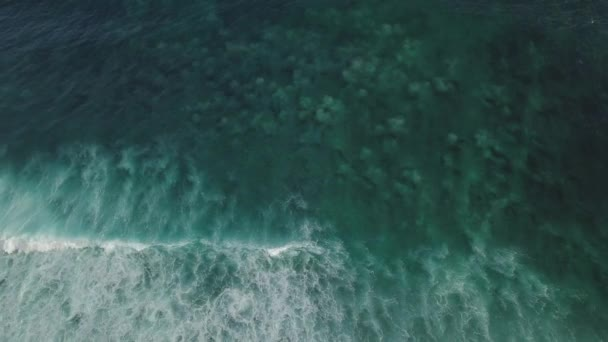 Aerial view of ocean waves breaking on reef.