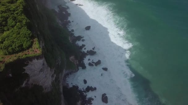 Stone cliffs, ocean waves and oceanscape. Aerial top view