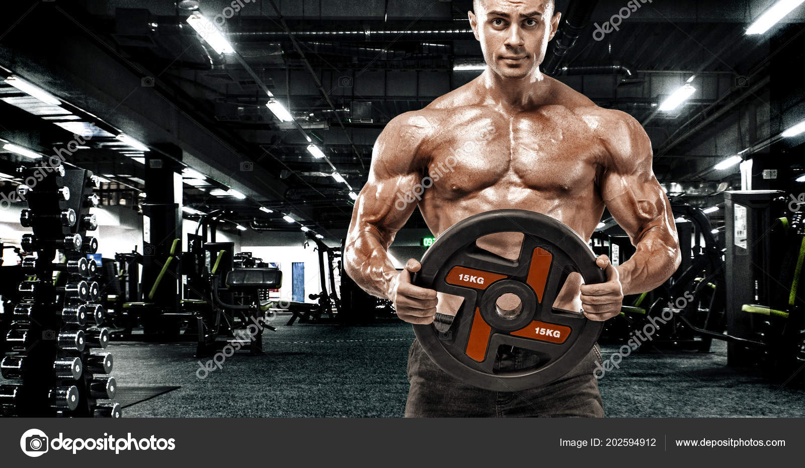 ba78082e62b ... pumping up muscles workout bodybuilding concept background - handsome  men · Athletic shirtless young sports man - fitness model with barbell in  gym.