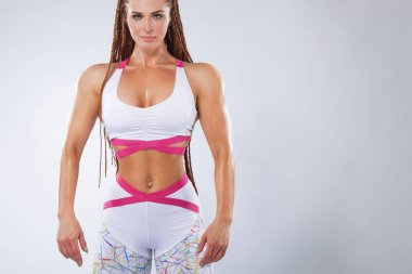 beautiful fitness woman with perfect body in shape wearing sport clothes for the gym training.