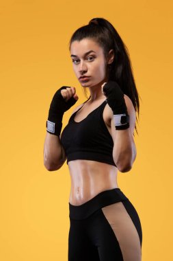 Sportsman, woman boxer fighting in gloves. on yellow background. Boxing and fitness concept.
