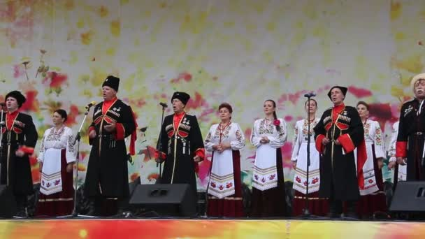 ANAPA, RUSSIA- SEPTEMBER 23, 2017: Amateur  choir sings songs. Men and women in Cossack clothes on stage. The concert at the celebration of the city Anapa