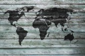 Fotografie world map on old wooden wall