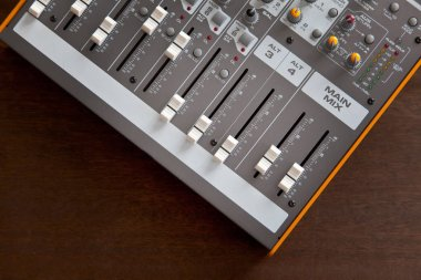 Audio studio sound mixer equalizer board sliders, faders and knobs, top view
