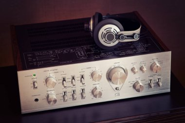 Vintage Audio Stereo Amplifier with Headphones Side View